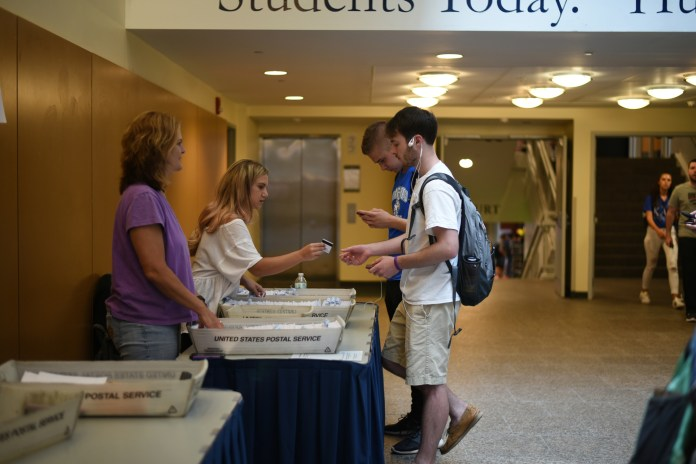 Students pick up their new UPasses in the Student Union on Aug. 28, 2017. (Charlotte Lao/The Daily Campus)