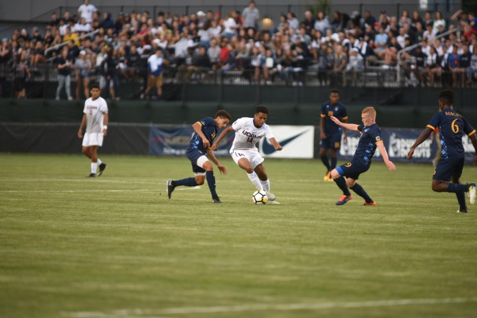 UConn midfielder Munir Saleh avoids Quinnipiac defenders during the Huskies 1-0 overtime victory over the Bobcats on Monday, Aug. 28, 2017. The Huskies hope to improve on the poor start to the season.(Charlotte Lao/The Daily Campus)