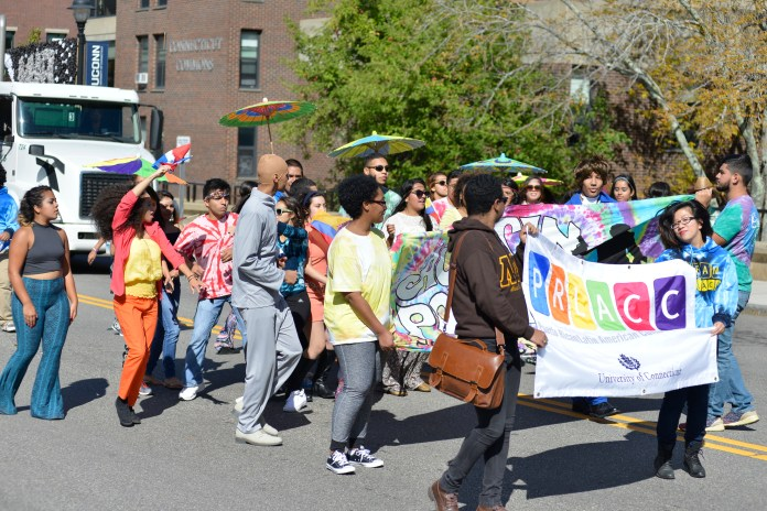 Members of the Puerto Rican/Latin American Cultural Center march in the 2015 Homecoming Parade on Oct. 11, 2017. (Jason Jiang/The Daily Campus)