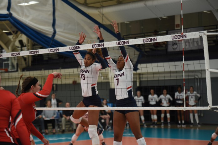 The Volleyball team defeats Hartford 3-0 on the final day of the Dog Pound Challenge improving their record is now 4-2. (Charlotte Lao/The Daily Campus)