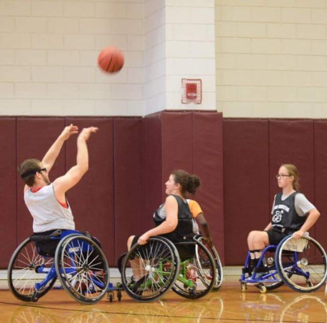 Students in the adaptive sports program enjoy a game of basketball. (Courtesy/Antonio Salazar)