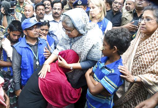 Bangladeshi Prime Minister Sheikh Hasina, center, meets with Rohingya Muslims at Kutupalong refugee camp, near the border town of Ukhia, Bangladesh, Tuesday, Sept. 12, 2017. (AP/Saiful Kallol)
