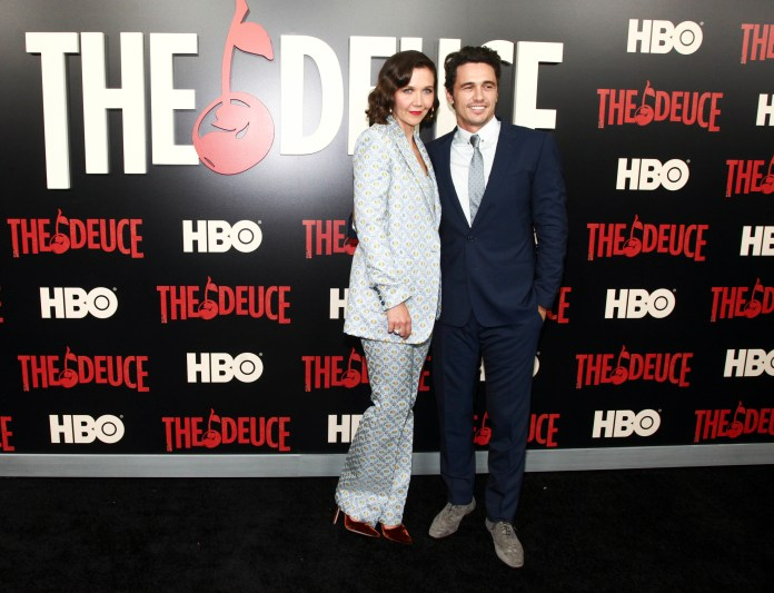 """Maggie Gyllenhaal, left, and James Franco, right, attend the premiere of the HBO Original Series """"The Deuce"""" at the SVA Theatre on Thursday, Sept. 7, 2017, in New York. (Andy Kropa/Invision/AP)"""