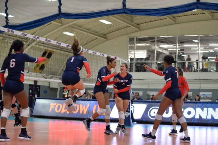 The UConn volleyball team celebrates a point (Amar Batra/The Daily Campus)
