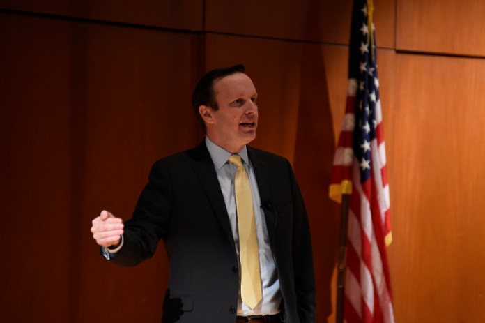 """U.S. Senator Chris Murphy talks his new foreign policy proposal, """"Rethinking the Battlefield"""" Konover Auditorium, Dodd Center on Tuesday, April 11, 2017. (Jason Jiang/The Daily Campus)"""