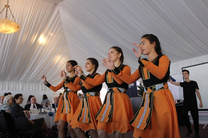 The Vanush Khanamiryan Dance Academy Troupe preforming several traditional Armenian dances for the introduction of the festival. (Josh Stanavage/The Daily Campus)