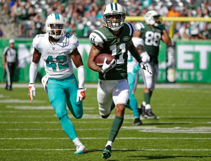 Miami Dolphins' Alterraun Verner (42) chases New York Jets' Robby Anderson (11) as Anderson runs for a touchdown during the first half of an NFL football game Sunday, Sept. 24, 2017, in East Rutherford, N.J. (AP Photo/Seth Wenig)