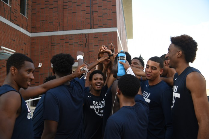 Members of the UConn men's basketball team finish another year of the annual Husky Run.(Charlotte Lao/The Daily Campus)
