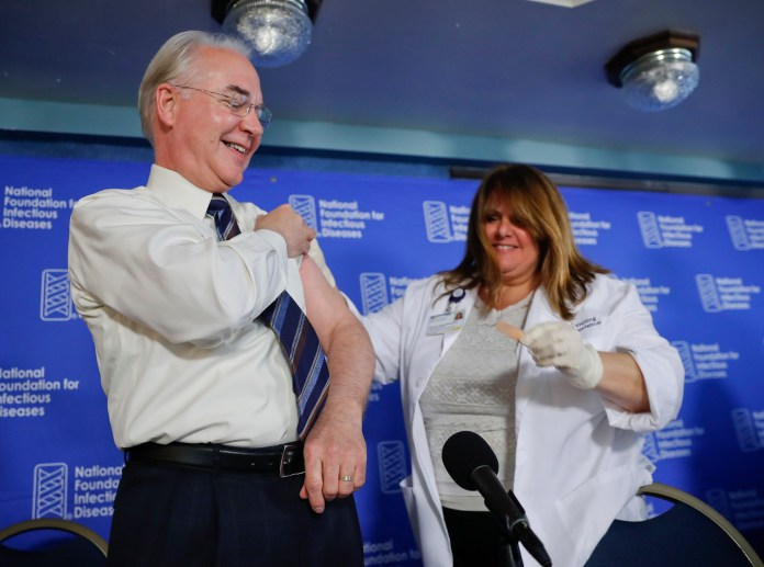 Health and Human Services Secretary Tom Price, left, is given a band-aid after a flu vaccination from Sharon Walsh-Bonadies, RN., right, during a news conference recommending everyone age six months an older be vaccinated against influenza each year, Thursday, Sept. 28, 2017 in Washington. (Pablo Martinez Monsivais/AP)