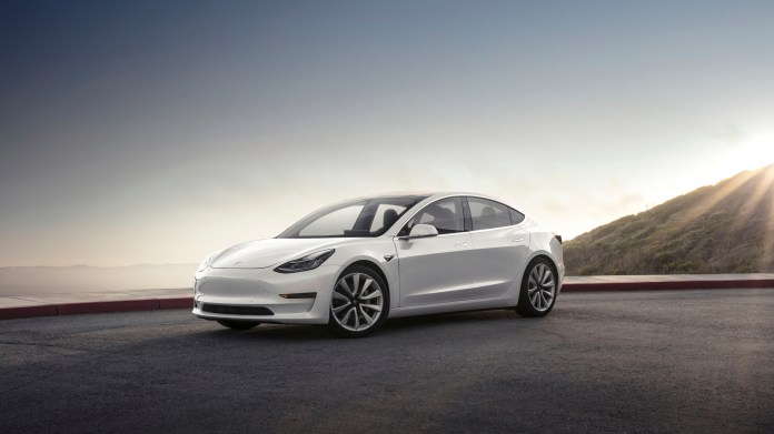 This photo provided by Tesla shows the 2017 Tesla Model 3, a compact electric sedan that offers two levels of range. It's the newest model from Tesla and slots below the Model S sedan in the company's lineup. (Tesla Inc/AP)