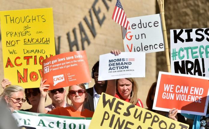 Anti-gun activists gather at a press conference Friday, Oct. 6, 2017, held by U.S. Senator Richard Blumenthal (D-Conn.), U.S. Senator Chris Murphy, and U.S. Congresswoman Rosa DeLauro. (Peter Hvizdak/AP)