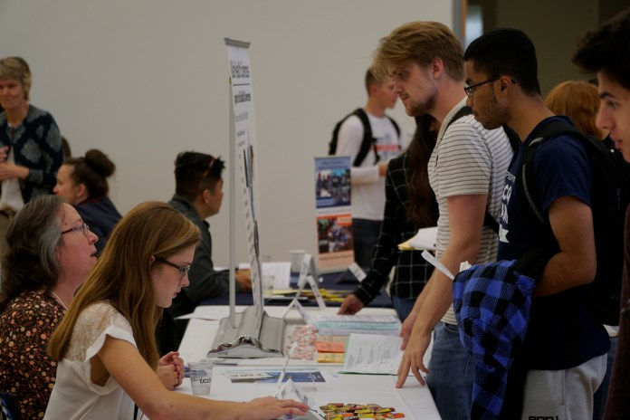 Students interact with professors and other students in the various departments and majors that UConn offers at The Major Fair in the Student Union ballroom on Wednesday, Oct. 11, 2017. (Eric Wang/The Daily Campus)