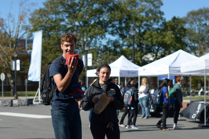A student plays cornhole during UConn Cigna Day hosted by Cigna Health Insurance held Fairfield Way to educate students about health and wellness on Thursday, Oct. 12, 2017. (Nicholas Hampton/The Daily Campus)