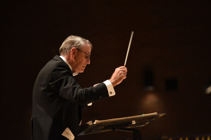 """UConn music professor Jeffrey Renshaw leads the UConn Wind Ensemble in their performance of """"21st Century Symphony"""" in von der Mehden Recital Hall on Thursday, Oct. 12, 2017. (Charlotte Lao/The Daily Campus)"""
