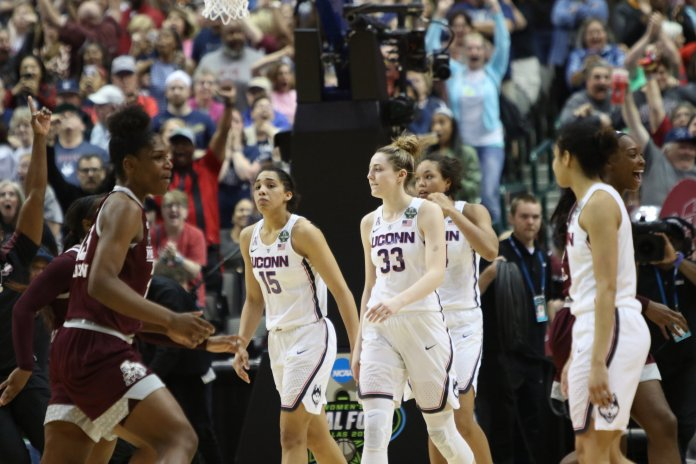 Katie Lou Samuelson (#33) and Gabby Williams (#15) walk off the court during the loss to Mississippi State on Friday, March 31. (Jackson Haigis/The Daily Campus)