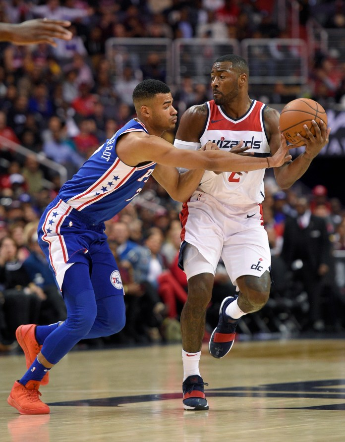 Philadelphia 76ers guard Timothe Luwawu-Cabarrot, left, reaches for the ball against Washington Wizards guard John Wall (2) during the second half of an NBA basketball game, Wednesday, Oct. 18, 2017. (Nick Wass/AP)