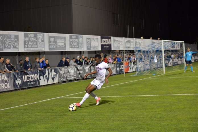 Abdou Mbacke Thiam (pictured) possess the ball in the Huskies home loss to Central Florida (Amar Batra/The Daily Campus)