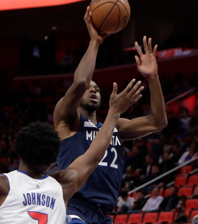 Minnesota Timberwolves guard Andrew Wiggins (22) shoots over Detroit Pistons forward Stanley Johnson (7) during the second half of an NBA basketball game, Wednesday, Oct. 25,2017, in Detroit. (Carlos Osorio/AP)