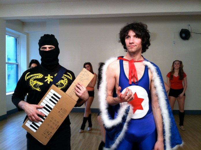 This is a picture of the two members of comedy band Ninja Sex Party, along with several background dancers from The Spangles, during the filming of their video Next To You. (Bwecht/Wikimedia Creative Commons)