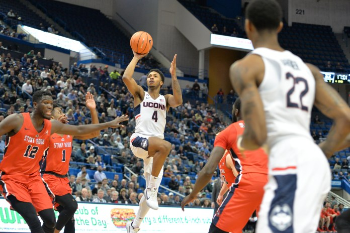 Jalen Adams attempting a shot in the UConn vs Stonybrook match up on November 14,2017. (Amar Batra/ The Daily Campus)