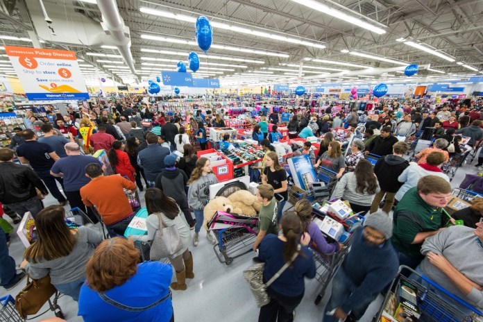 IMAGE DISTRIBUTED FOR WALMART - Holiday shoppers scored great deals at Walmart on Thursday, Nov. 23, 2017 in Bentonville, Ark. Color coded departments in Walmart stores helped customers locate top products across categories including electronics, toys, home, and apparel. (Gunnar Rathbun/AP Images for Walmart)