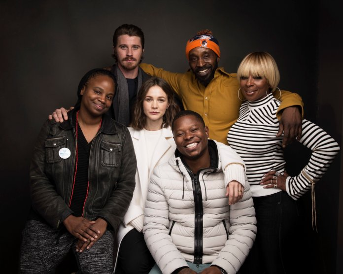 """In this Jan. 21, 2017 file photo, director Dee Rees, clockwise from left, actors Garrett Hedlund, Rob Morgan, Mary J. Blige, Jason Mitchell, Carey Mulligan, middle row center, pose for a portrait to promote the film, """"Mudbound"""" during the Sundance Film Festival in Park City, Utah. (Photo by Taylor Jewell/Invision/AP, File)"""
