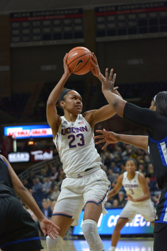 Azura Stevens looks for an open teammate during the Huskies 78-60 victory over the Tulsa Golden Hurricane in Gampel Pavilion on Thursday, Jan. 18, 2018. Stevens led the team in scoring, putting up 22 points. (Charlotte Lao/The Daily Campus)
