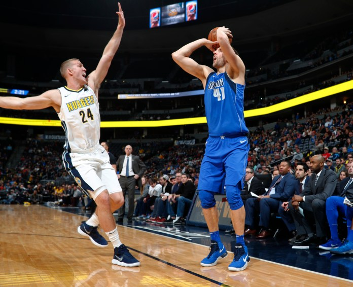 Dallas Mavericks forward Dirk Nowitzki, right, of Germany, squares up for a three-point basket as Denver Nuggets center Mason Plumlee defends in the first half of an NBA basketball game Tuesday, Jan. 16, 2018, in Denver. (David Zalubowski/AP)