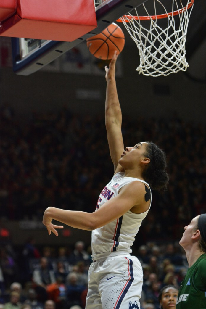 Williams showcases her versatility on the boards against the Green Wave (Olivia Stenger/The Daily Campus)