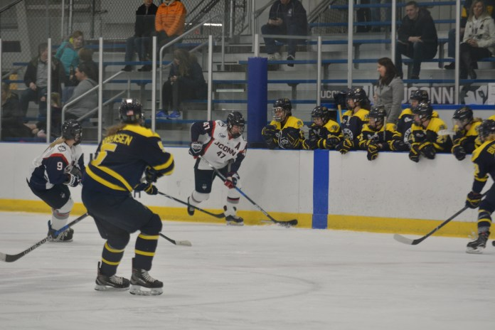 Junior Jaime Fox moves the puck against Merrimack in Hockey East action (Jon Sammis/The Daily Campus)
