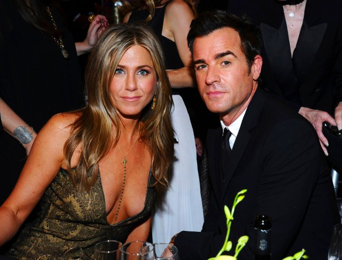 FILE - In this Jan. 25, 2015 file photo, Jennifer Aniston, left, and Justin Theroux pose in the audience at the 21st annual Screen Actors Guild Awards in Los Angeles. The couple announced Thursday, Feb. 15, 2018, that they have separated. (Vince Bucci/Invision/AP, File)