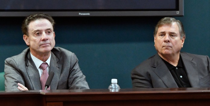 In this Oct. 20, 2016, file photo, University of Louisville head basketball coach Rick Pitino, left, and Athletic Director Tom Jurich listen during a press conference, in Louisville, Ky. Louisville must vacate its 2013 men's basketball title following an NCAA appeals panel's decision to uphold sanctions against the men's program for violations committed in a sex scandal.(AP Photo/Timothy D. Easley, File)