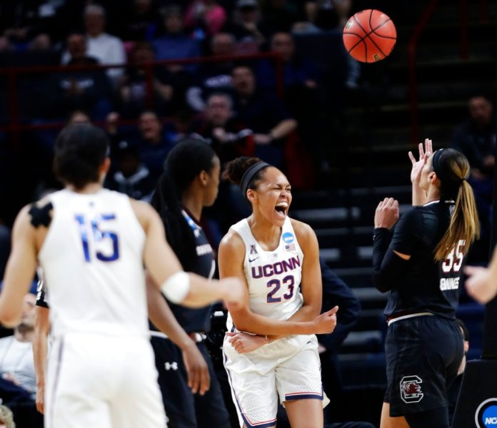 Connecticut's Azura Stevens (23) celebrates after scoring during the first half of a regional final against South Carolina at the a women's NCAA college basketball tournament Monday, March 26, 2018, in Albany, N.Y. (AP Photo/Frank Franklin II)