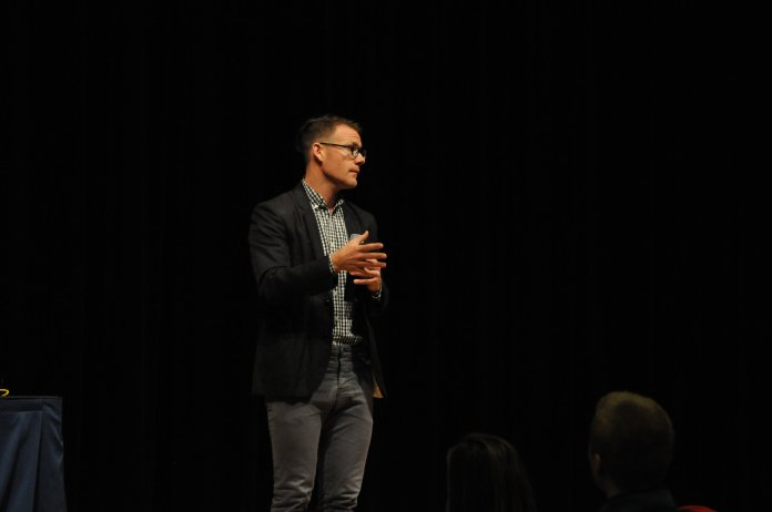 Author and learning activist Jonathan Mooney speaks to students to close out the 50th anniversary celebration for UConn's Center for Students with Disabilities on April 4th, 2018 at the Student Union Theater.(Judah Singleton/The Daily Campus)