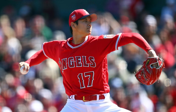 FILE - In this Feb. 24, 2018, file photo, Los Angeles Angels' Shohei Ohtani works against the Milwaukee Brewers during the first inning of a spring training baseball game, in Tempe, Ariz. Ohtani had general managers scrambling this winter with his jump to the major leagues. They weren't alone. For the folks who write the code that tracks stats for fantasy baseball websites, Ohtani's two-way talents have caused quite a conundrum. (AP Photo/Ben Margot, File)