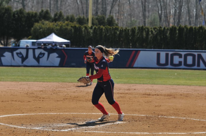 Jill Stockley (2) winds up a pitch during the Huskies weekend series victory against the UCF Knights on April 7, 2018. (Jon Sammis/The Daily Campus)