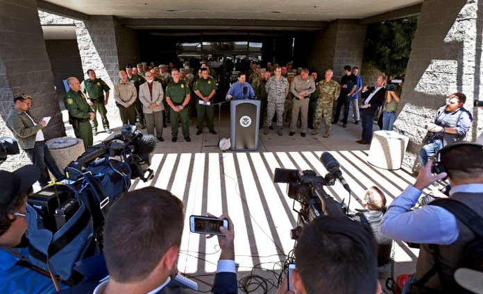 Arizona Gov. Doug Ducey, backgrounded by National Guard troops and Border Patrol agents, addresses a throng of media during a press conference to address Operation Guardian Support at the Nogales Border Patrol Station, 1500 W. La Quinta Road, on April 13, 2018, in Nogales, Ariz. Arizona Governor Doug Ducey is sending National Guard troops to the United States-Mexico border. (Mike Christy/Arizona Daily Star via AP)