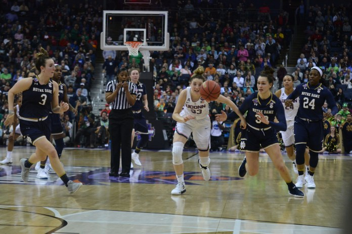 The women take on Notre Dame in the first game of the NCAA Final Four on Friday, March 30. After a close and tough game, the Huskies lost in overtime with a final score of 92-89. (Olivia Stenger/The Daily Campus)