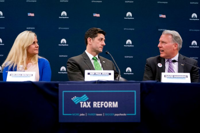 House Speaker Paul Ryan of Wis., center, accompanied by Melissa Bercier of Couch Clarity, Ill., left, listens to TCW President David Manning, right, as he speaks during a roundtable with American taxpayers on tax reform on Capitol Hill, Tuesday, April 17, 2018, in Washington. (AP Photo/Andrew Harnik)