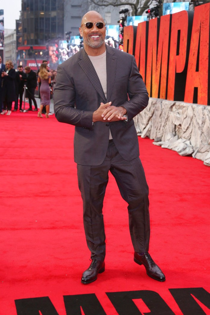 Actor Dwayne Johnson poses for photographers upon arrival at the premiere of the film 'Rampage' in London, Wednesday, April 11, 2018. (Photo by Joel C Ryan/Invision/AP)