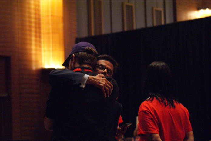 Dr. Prasad Srinivasan hugs a campaign staffer, thanking them for their hard work, after he is eliminated from the ballot after the first round of voting.