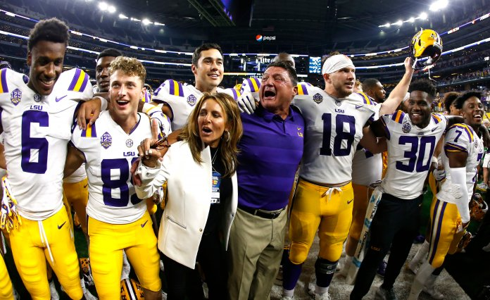 LSU coach Ed Orgeron celebrates with his team following a 33-17 win over Miami in an NCAA college football game Sunday, Sept. 2, 2018, in Arlington, Texas. (AP Photo/Ron Jenkins)