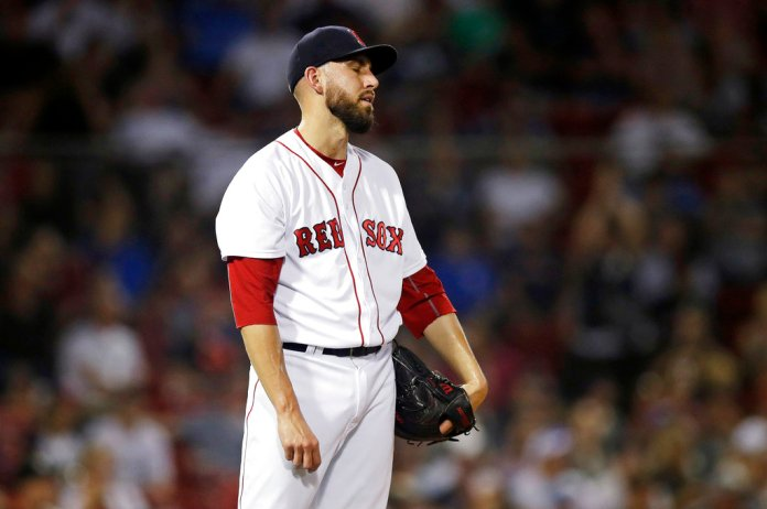Boston Red Sox relief pitcher Matt Barnes reacts after giving up a home run to Miami Marlins' Starlin Castro, which tied the game at 4-4, during the eighth inning of a baseball game at Fenway Park in Boston, Tuesday, Aug. 28, 2018. (AP Photo/Charles Krupa)