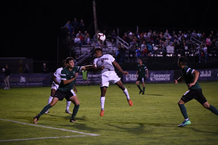Dayonn Harris is heads and shoulders above the competition against Dartmouth College on Sept. 8.(Charlotte Lao/ The Daily Campus)