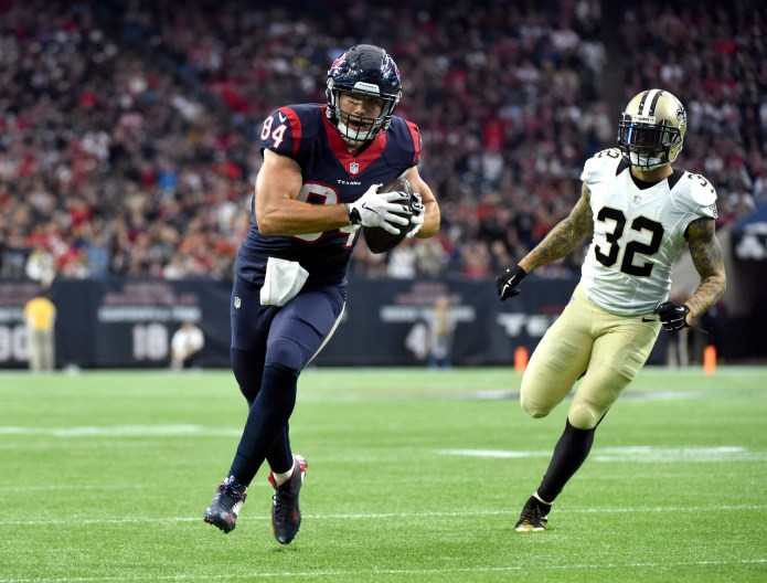 Houston Texans tight end Ryan Griffin (84) runs toward the end zone as New Orleans Saints strong safety Kenny Vaccaro (32) defends during a game on Sunday, Nov. 29, 2015, in Houston. (Eric Christian Smith/AP)