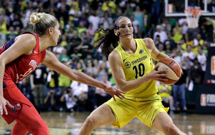 Seattle Storm's Sue Bird moves as Washington Mystics' Elena Delle Donne defends in Game 2 of the WNBA basketball finals, Sept. 9, 2018, in Seattle. (AP Photo/Elaine Thompson)