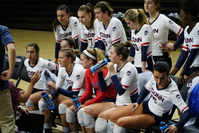 The Husky ladies took down the Quinnipiac Bobcat's 3-0. Outside hitters Caylee Parker (14) and Iman McGary (15) lead the team in kills. Their next games are on Friday 8/31 against UNH and Iona College. (Eric Wang/The Daily Campus)