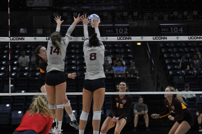 The UConn Huskies Women's Volleyball Team plays against the Iona Gaels at Gampel Pavilion on August 31, 2018. The game resulted in a win for the Huskies. (Photo by Judah Shingleton)