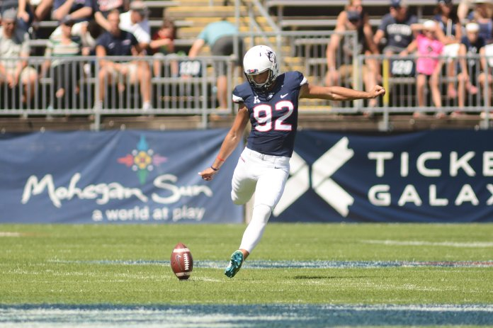 The UConn Huskies won 56-49 to the URI Rams, lead by David Pindell (5) with 308 passing yards and 265 rushing yards. They'll take on Syracuse on 9/22 next. (Eric Wang/The Daily Campus)