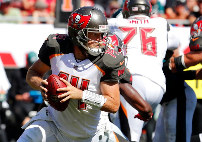 """FILE - In this Sunday, Sept. 16, 2018, file photo, Tampa Bay Buccaneers quarterback Ryan Fitzpatrick (14) rolls out during the second half of an NFL football game against the Philadelphia Eagles in Tampa, Fla. Miami Dolphins rookie safety Minkah Fitzpatrick wants to trademark his nickname but says he'd be happy to share it with Buccaneers quarterback Ryan Fitzpatrick. Both go by """"FitzMagic."""" (AP Photo/Mark LoMoglio, File)"""